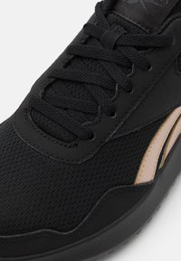 Reebok - ENERGEN LITE - Neutral running shoes - core black/golden bronze/cold grey - 5