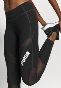 Puma - PAMELA REIF X PUMA COLLECTION MID WAIST - Leggings - black - 4