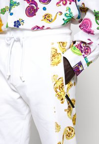 Versace Jeans Couture - JOGGERS GIOIELLI SIDE STRIPE - Tracksuit bottoms - white - 7