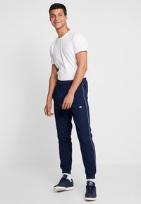 adidas Originals - TRACK BOTTOM - Pantalones deportivos - night indigo - 1