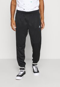 Nike Sportswear - REPEAT - Tracksuit bottoms - black/reflective silver - 0