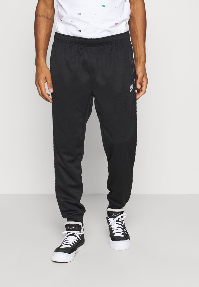 Nike Sportswear - REPEAT - Tracksuit bottoms - black/reflective silver