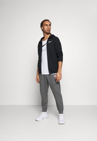 Nike Sportswear - CLUB - Pantalon de survêtement - charcoal heathr/anthracite/white - 1