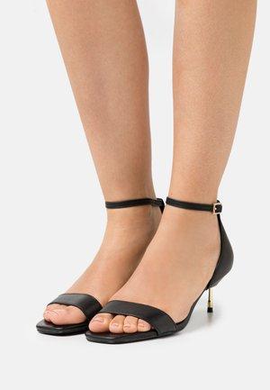 BIRCHIN - Sandals - black