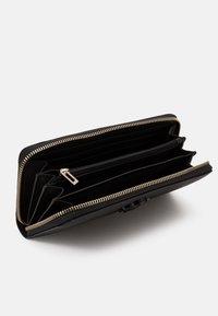 Guess - NOELLE LARGE ZIP AROUND - Wallet - black - 2