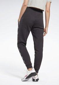 Reebok - TAPE JOGGERS - Pantaloni sportivi - black - 2