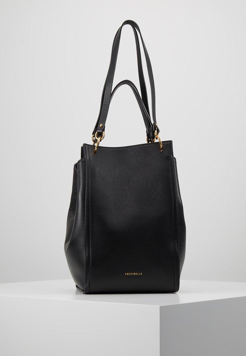 Coccinelle - MADELAINE - Handbag - noir