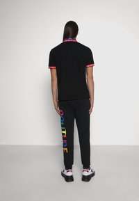 Versace Jeans Couture - ORGANIC BRUSHED - Tracksuit bottoms - black - 3