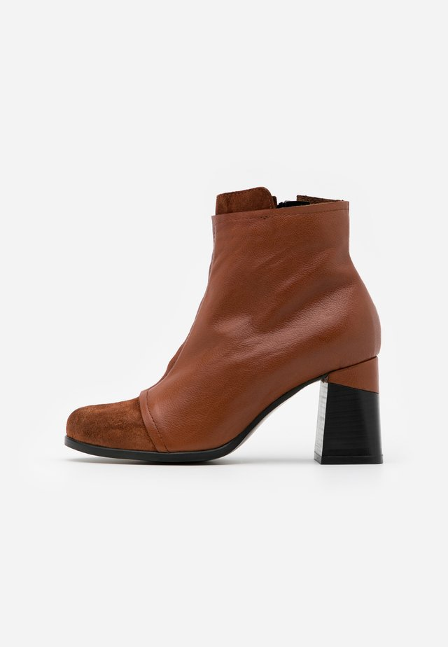 High heeled ankle boots - prince coroil almond