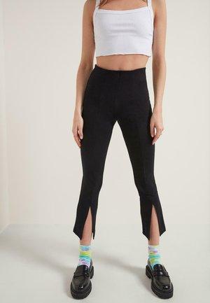 MIT SCHLITZEN - Leggings - Trousers - nero