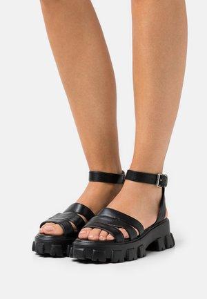 WIDE FIT HARMONIE - Platform sandals - black