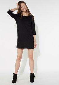 Tezenis - MIT U-BOOT-AUSSCHNITT - Jersey dress - nero - 1