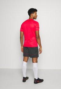 Nike Performance - SHORT - Sports shorts - black/siren red - 2