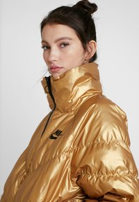Nike Sportswear - FILL SHINE - Winter jacket - metallic gold/black - 4