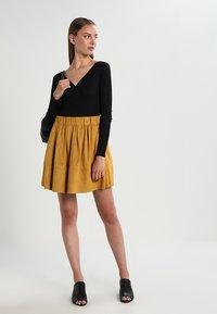 Moves - KIA - A-line skirt - mustard yellow - 1