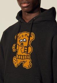 sandro - HOODIE TEDDY - Sweatshirt - noir - 4