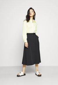 Monki - SIGRID BUTTON SKIRT - A-line skirt - black dark solid - 1