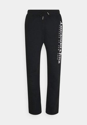 TECH LOGO CLASSIC - Teplákové kalhoty - black
