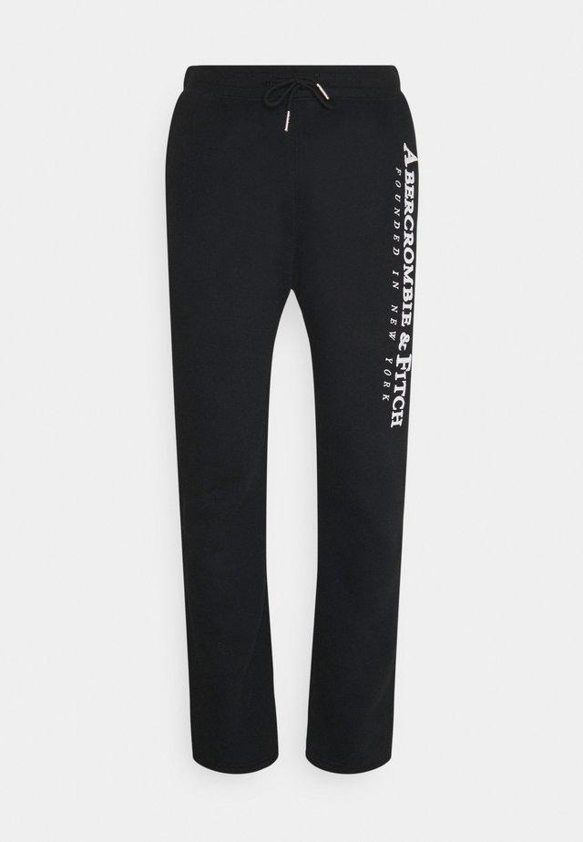 TECH LOGO CLASSIC - Pantalon de survêtement - black