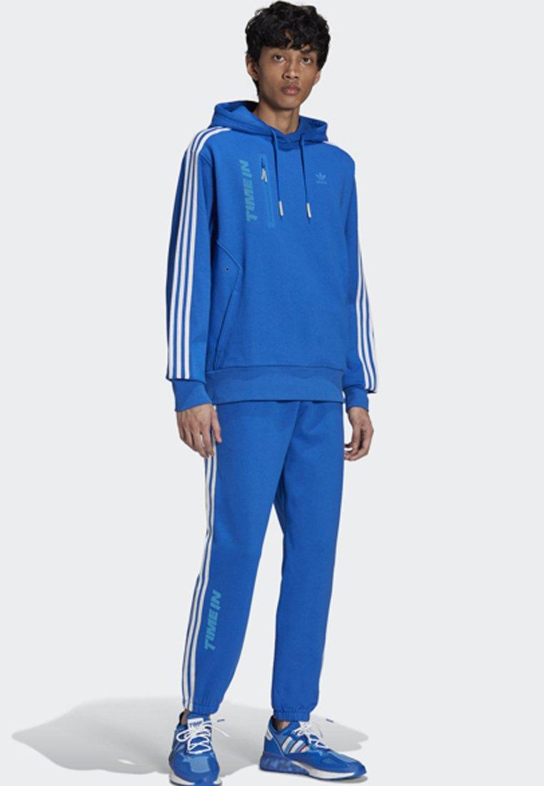 adidas Originals - NINJA PANT UNISEX - Tracksuit bottoms - blue
