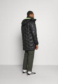 Diesel - W-RUSSELL-LONG-THERMO JACKET - Winter jacket - black - 2