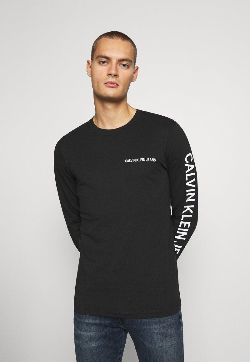 Calvin Klein Jeans - ESSENTIAL INSTIT TEE UNISEX - Long sleeved top - black