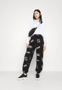 Topshop - VIRTUAL REALITY - Tracksuit bottoms - black - 1