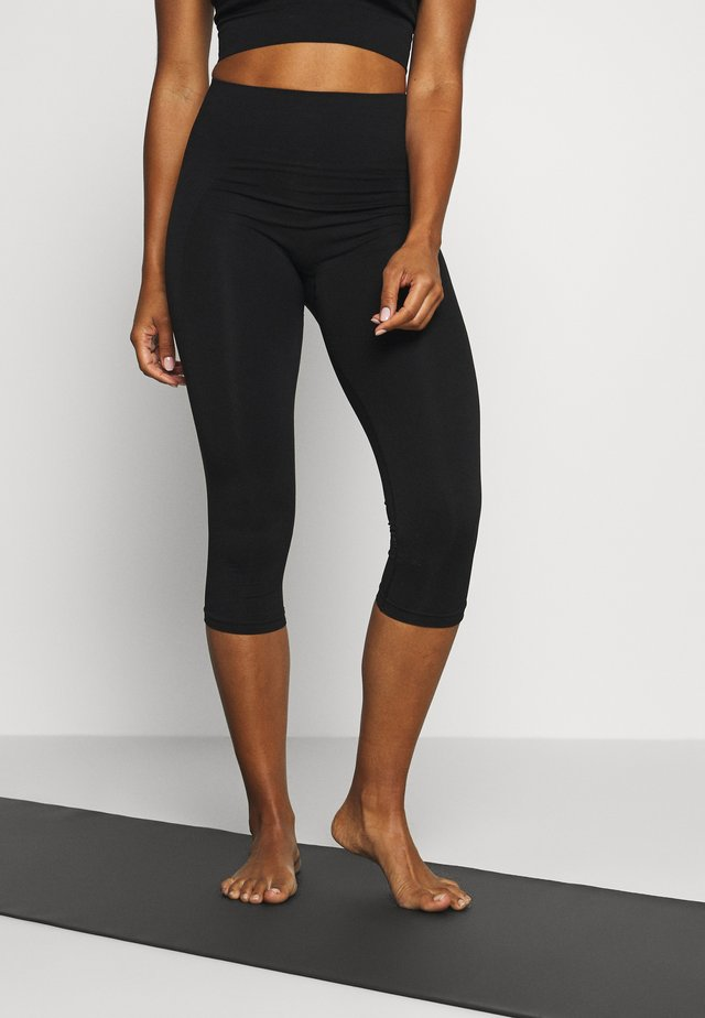 CROPPED SEAMLESS LEGGING - 3/4 sports trousers - black