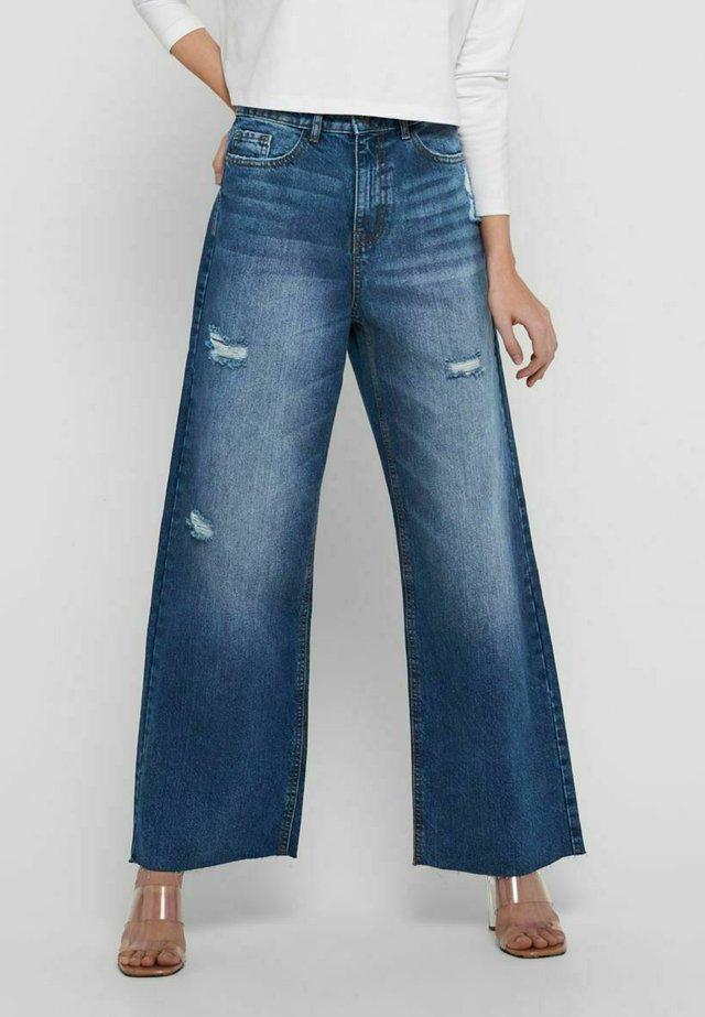 Jeans a zampa - medium blue denim