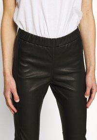 Cream - MIRA PANTS - Kožené kalhoty - pitch black - 4