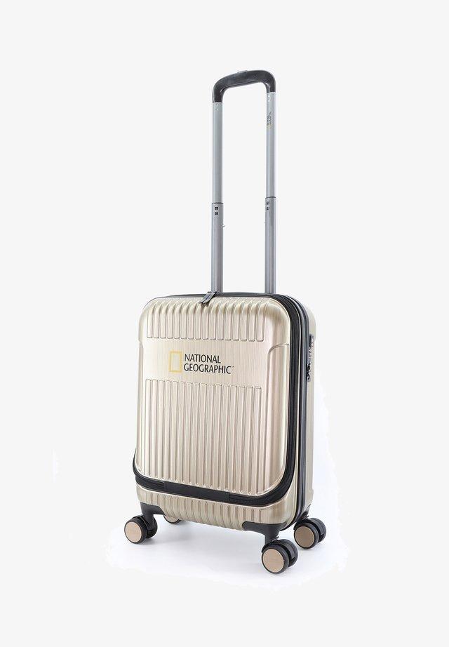 TRANSIT - Wheeled suitcase - gold