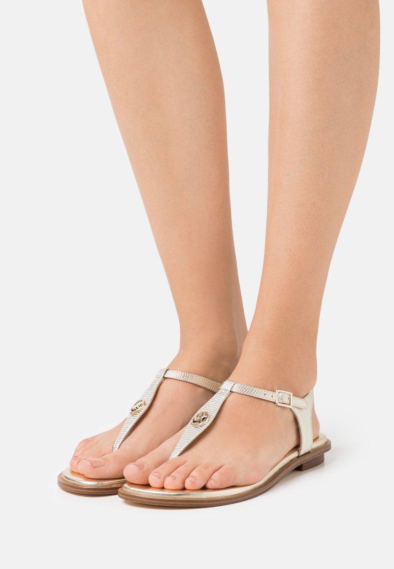 MICHAEL Michael Kors - MALLORY THONG - T-bar sandals - pale gold