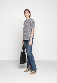Bruuns Bazaar - SEER ADELAIA BLOUSE - Blouse - black/white - 1
