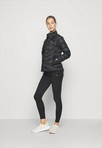 Puma - PWRWARM PACKLITE JACKET - Down jacket - black - 1