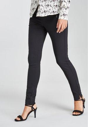 SKINNY ZIP - Trousers - black