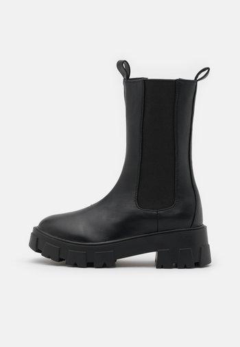 WIDE FIT ELLERY - Platform boots - black