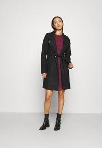 Vero Moda - VMJUHI JACKET - Classic coat - black - 1