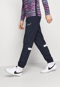 Nike Performance - PANT - Tracksuit bottoms - obsidian/white - 3
