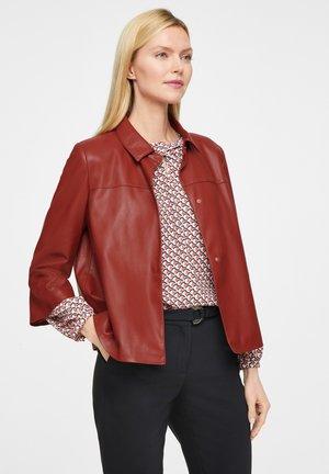 MIT TROMPETENÄRMEL - Faux leather jacket - burned sienna