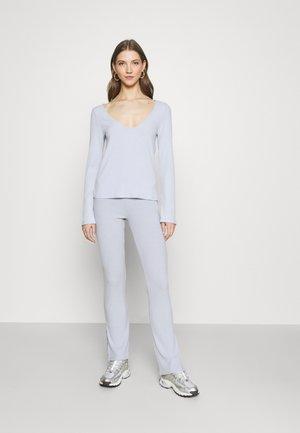 FLIRTY SET - Pantaloni - light blue
