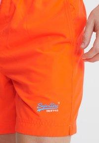 Superdry - WATERPOLO - Swimming shorts - havana orange - 2