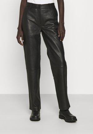 TIMEA - Leather trousers - jet black