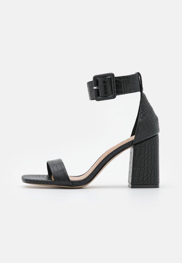 ELENNA - Sandaalit nilkkaremmillä - black