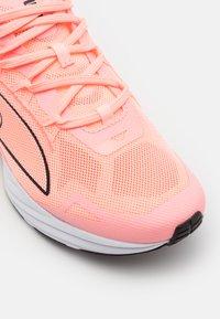 Puma - ULTRARIDE - Neutral running shoes - elektro peach/black/white - 5