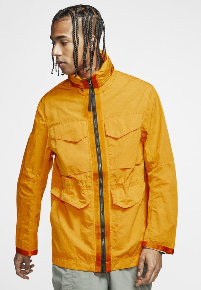 Outdoor jacket - kumquat/black