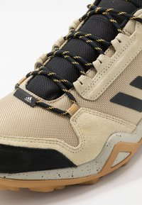 adidas Performance - TERREX AX3 - Hikingschuh - legend gold/core black/solar gold - 5