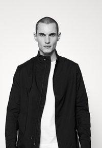 J.LINDEBERG - HOLGER LIGHTWEIGHTZIP - Classic coat - black - 3