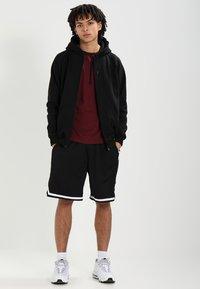 Urban Classics - STRIPES - Pantalon de survêtement - black/black/white - 1