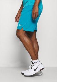 Nike Performance - FLX ACE - Pantalón corto de deporte - neo turquoise/white - 3