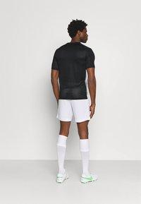 Nike Performance - ACADEMY - T-shirt print - black/white - 2